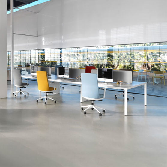 Actiu Prisma Bench Desk shown with colorful office chairs