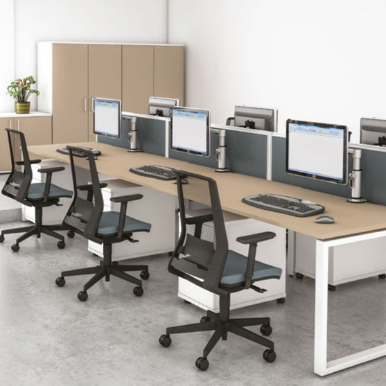 Bench Desks by Imperial shown with black chairs