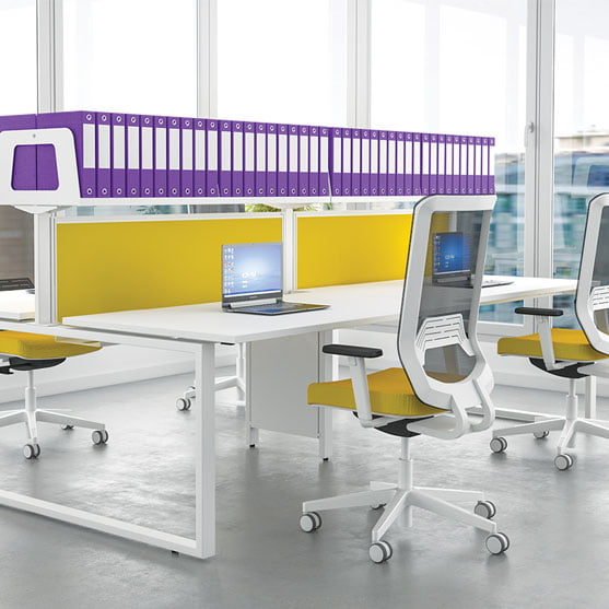 Imperial bench desks shown with yellow dividers
