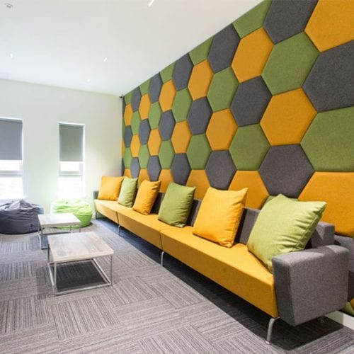 yellow, green and grey hexagon eden wall mounted acoustic panel era in situe