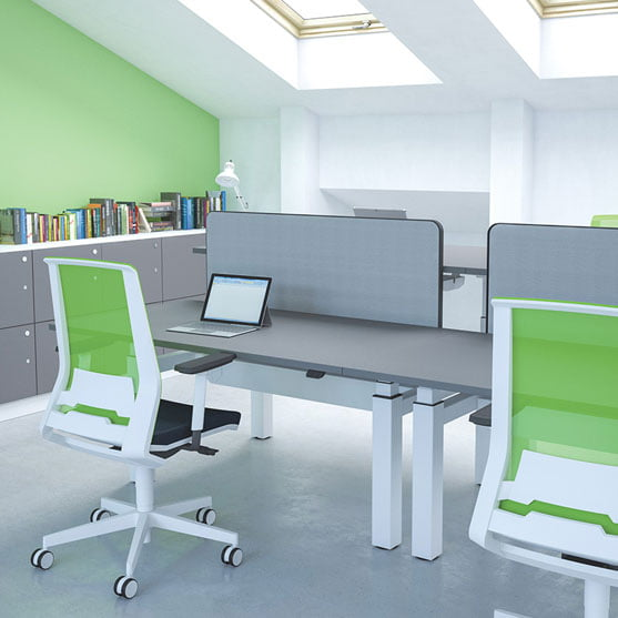 Freedom Height Adjustable Desk shown with a green office Chair