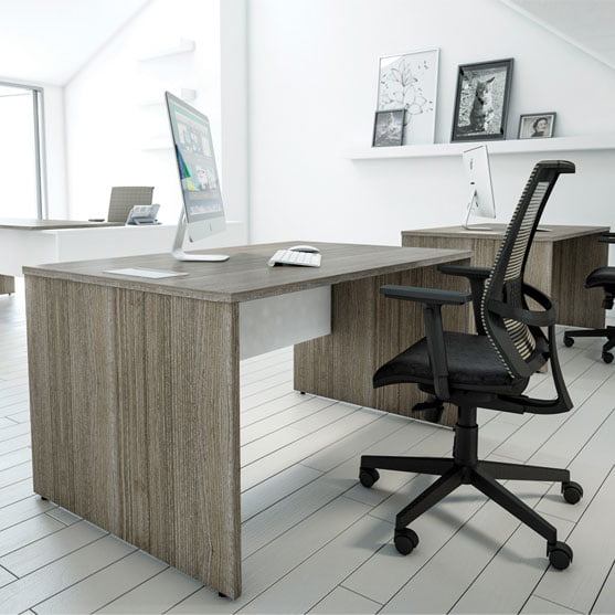 I Executive Straight Desk shown in an office