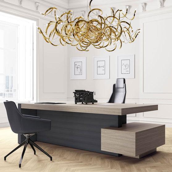 Jera Executive Desk shown with a modern lightingg