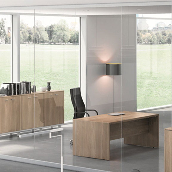 Executive Desk T45 shown in amodern office with mirrors