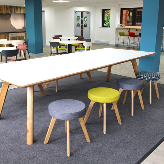 Centro Tables white top shown in a modern space