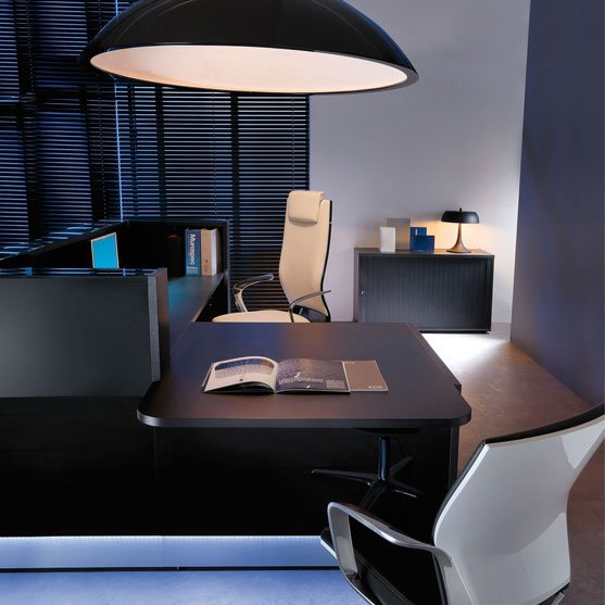 Showing Linea Reception Desk in black with a lamp