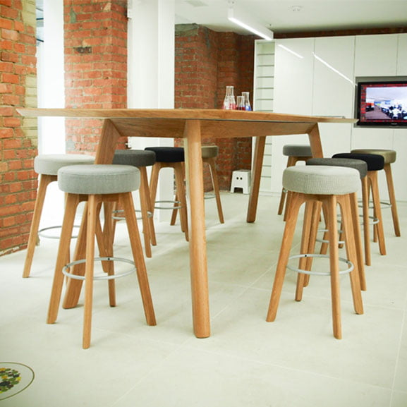 Centro Work Table shown with stools