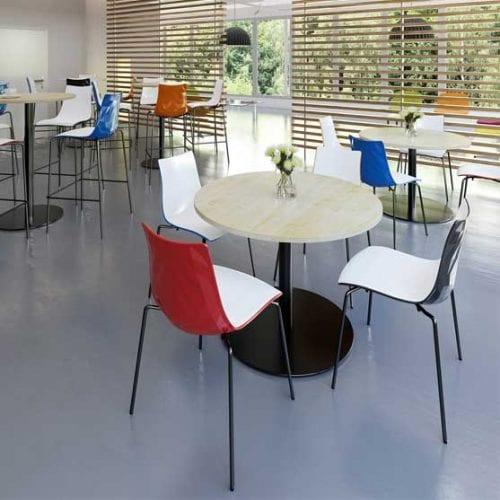 Monza Circular Table shown in a coffee area