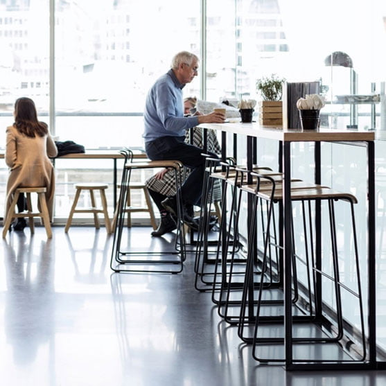 Transit High Stool in a modern coffee area
