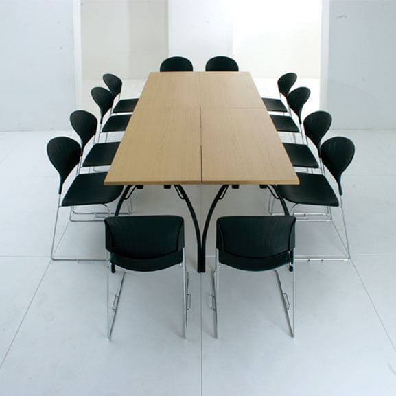 Telford folding table shown in a meeting room