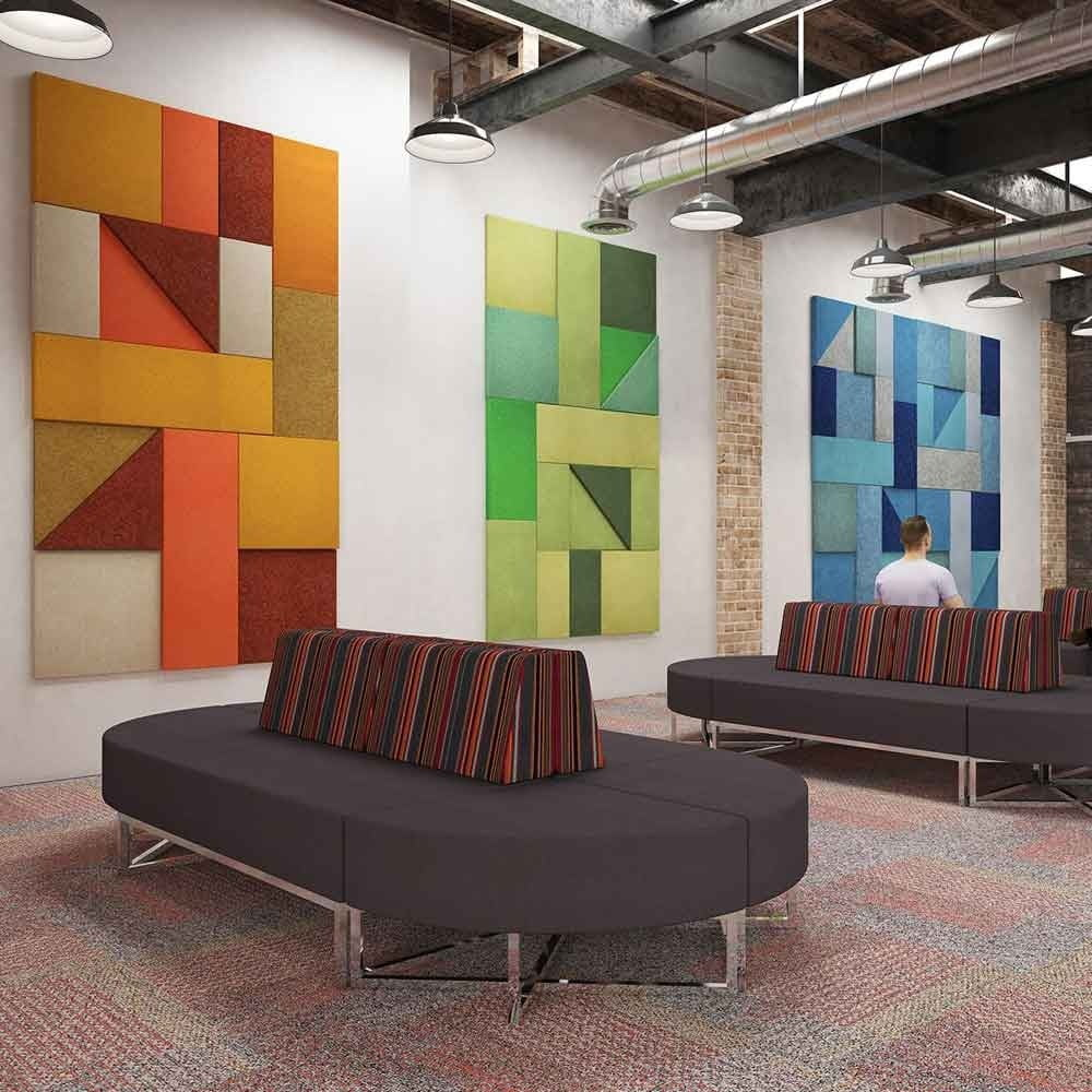 Multi-coloured decorative acoustic shapes reducing noise on an office wall