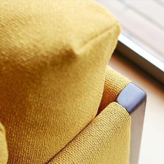 Bodie cushion arm chair boss design