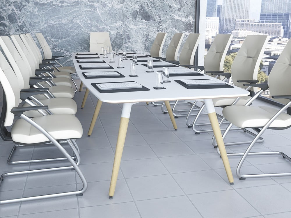 White boardroom table with 13 places